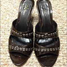 Dark brown Cole Haan wedges These are loved deep and dark brown wedges with thread detail on top. 3 inch wedge. Extremely comfy. True to size. They are actually in quite good shape inside but for the 4th pic which you can see the close up showing what happens when the carpet monster gets you. (In other words, I'm clumsy so I trip over my own two feet and the shoe suffered a little scuff.) But it's not terribly noticeable when on and certainly no one is holding a magnifying glass to your…
