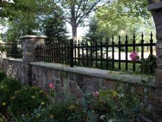 Custom metal fence on stone wall - Home and Garden Design Idea's … Front Yard Fence, Fence Gate, Fenced In Yard, Rod Iron Fences, Wrought Iron Fences, Stone Fence, Metal Fence, Wood Fence Design, Gates And Railings
