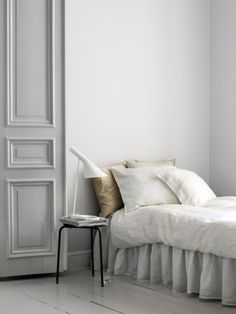 Beautiful Bedroom. Great for a guest bedroom. Love the paneled Door & the simple & chic Bedding.