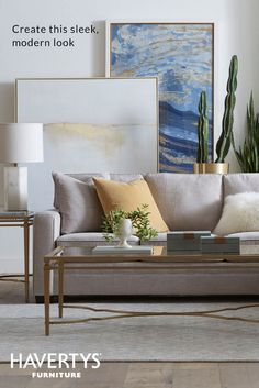 CHIC FRAME OF MIND  These framed art pieces create the perfect backdrop for a soft sofa in a classic silhouette. Neutral fabrics pair well with pops of color and metallic accents, while unexpected greenery (real or faux!) bring the space to life.