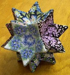 Rhombic Hexecontahedron - 12 kaleidoscopes would make beautiful Christmas ornaments :) Quilted Christmas Ornaments, Fabric Ornaments, Christmas Fabric, Christmas Diy, Holiday, Fabric Crafts, Sewing Crafts, Sewing Projects, Christmas Makes
