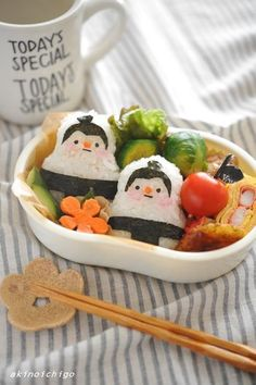 Cute sumo wrestler onigiri (made from rice, nori, ham, & carrot) bento box