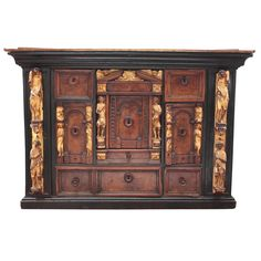 Early Italian Bambocci cabinet of Walnut and Ebony with Giltwood Figures dating 17th century. Possibly, Genoa or Liguria| From a unique collection of antique and modern cabinets at https://www.1stdibs.com/furniture/storage-case-pieces/cabinets/