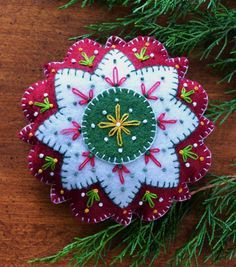 Nordic Star www.americanhomesteaddesign. Maria L.Bertolino/. christmas embroidered felt ornament