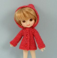 Amelia Thimble in red knit jacket