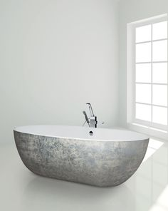 The Stone One Stracciata : a free-standing bathtub with white Cristalplant inside and decor grey on white finish outside.