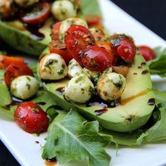 """Healthy Tomato & Mozzarella Filled Avocado!  Recipe Serves 4  1 pint of cherry or grape tomatoes cut in halves 8 oz or ½ lb of low fat mozzarella pearls…"""