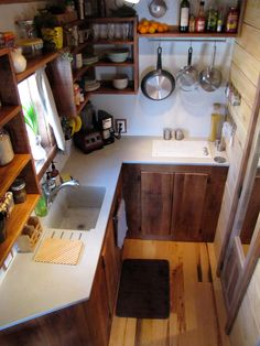 wind-river-bungalow-2 Nice kitchen for full time living in a tiny house - but no oven. I like the cooktop inset into the counter.