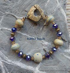 Artisan lampwork glass & crystal bracelet. www.facebook.com/bubbasbeads