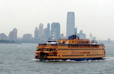 10 Best Ways To Enjoy NYC On A Budget - Commuters ride the Staten Island ferry in New York. Staten Island Ferry, City That Never Sleeps, I Want To Travel, New York Travel, Travel Bugs, San Francisco Skyline, New York Skyline, Budgeting, Places To Visit