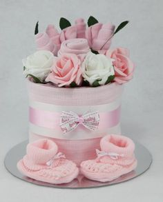 An individually designed hand crafted baby clothes flower bouquet single tier nappy cake which is available in a choice of three colours Contents: 7 Pampers