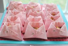 Paper Diapers: All you need is a package of napkins (your choice of color) and the appopriate amount of safety pins. SO easy and they make any treat that you're serving look completely adorable. Obviously the smaller your napkins, the smaller your little diapers so buy the size according to what you are going to serve in them.  These also make awesome party favor bags!