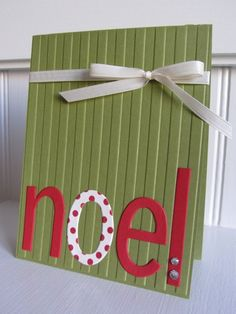 Simple wainscoating embossing on the card base and some die cut letters with personality and you have this ?DIY Christmas card.  Add rhinestones to the letters or keep them simple.  This olive green is pretty behind the red and white.