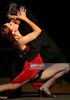 Florencia Roldan and Juan Malizia Gatti from Argentina, dance the tango 'Tanguera' during the semifinal of the Tango Escenario competition in Buenos Aires on August 24th, 2006, in the framework of the IV World Tango Championship. Competitors from Japan, Colombia, New Zealand, Germany, Spain, Chile, Uruguay and 15 other countries, along with 339 Argentine couples take part in the event - a mixture of artistic festival and competition. AFP PHOTO/Daniel GARCIA