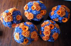 Orange and Blue (GO 'CUSE) centerpieces Blue Hydrangea, orange roses and gerbs