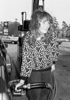 Sarah Ferguson a month before she became engaged to Prince Andrew refuels her car close to her home in Hampshire on February 17 1986 in Hampshire...