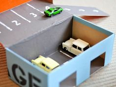 Shoebox car garage is a great way to store and play with cars. #crafts http://www.ivillage.com/kids-crafts-make-cardboard-box/6-b-521598#521630
