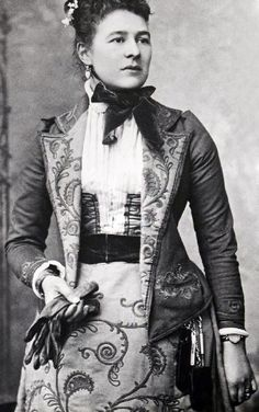 Ishbel, Countess of Aberdeen, 1891. Looks like she was an early adopter of the wristwatch. Her ensemble, though, is puzzling. It looks more like a stage costume than real clothing. Perhaps it was made for a fancy dress ball. (But then why the keys and the watch?) McCord Museum