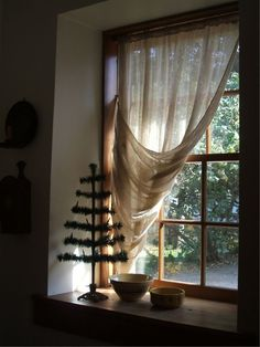 Beautiful wooden window and simple primitive style window treatment