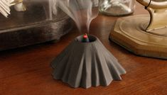VOLCANO  ACTIVATE A VOLCANO   INCENSE HOLDER CONCRETE MEASUREMENTS: 10 CM x 5 CM (H) INCENSE INCLUDED REF.: AT30223  MADE IN FRANCE DESIGN...