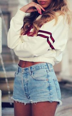 WHITE CROP TOP WITH 2 MAROON LINES GOING AROUNG THE  CROP TOP/SWEATER (IN THE MIDDLE) AND SOME LIGHT HIGH WAISTED SHORTS