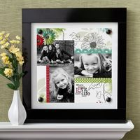Sure, Moms like flowers and candy. But why not go for a gift that will hang on her wall for her to see every single day and think of you? A pretty 12x12 Page Print (US|Canada) featuring photos of loved ones framed with a Sleek Magnetic Everyday Display (US|Canada) is a gift she'll surely treasure forever. Who wouldn't? For this project (featuring the Enchanted Digital Power Palette (US|Canada)), I created a new 12x12 page print project, then added Enchanted Paper 5 (rotated 90 degrees), thre...