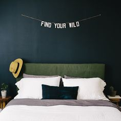 I like the square dark canvas headboard, with a dark background and small focal point