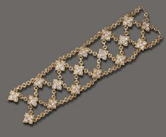 A DIAMOND AND GOLD BRACELET, BY VAN CLEEF & ARPELS | Christie's. The flexible wide openwork band, composed of textured gold circular links, accented by circular-cut diamond quatrefoil motifs, mounted in 18k gold, 7½ ins., with French assay marks and maker's mark, in a Van Cleef & Arpels blue suede case (price realized: 16, 730)