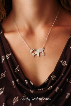 World map sterling silver or gold pendant necklace by IvyByDesign on Etsy. This necklace is absolutely gorgeous and the detail is amazing! This is a