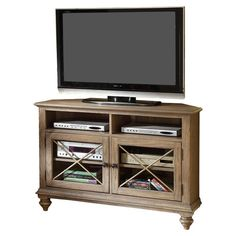 Add country-chic appeal to your living room or den with this weathered ash wood media console, showcasing 2 open shelves, 2 glass doors with cross overlays, . Corner Tv Console, Riverside Furniture, Riverside House, Cool Tv Stands, Home Entertainment, Corner Designs, Country Chic, Wood Veneer, Adjustable Shelving