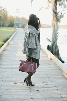 {Classic: black pencil skirt, Louboutin pumps, long leather gloves, and a lady-like coat}