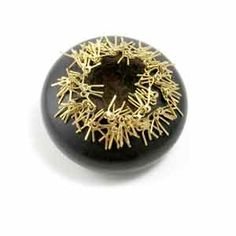 TINA RATH-USA, brooch Black Beauty: Brooch #3   2003  ebony, mink, 18k gold  Jeweler, who likes to use intricate natural elements for her design
