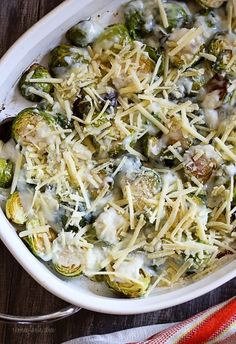 Brussels Sprouts Gratin are the perfect Holiday side dish! The brussels sprouts are roasted until crisp, then topped with a light cheese sauce made with Gruyere and parmesan, and baked until brown and bubbling. If you are as obsessed with brussels sprouts as I am, you'll love these.