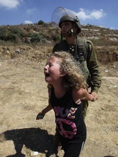 Israeli soldiers arrest prominent activist Nariman Tamimi for taking part in a peaceful protest against the theft of Palestinian land by Israel, on August James Nachtwey, Steve Mccurry, Robert Doisneau, Heiliges Land, Religion, Girl Back, Peaceful Protest, We Are The World, Peace On Earth