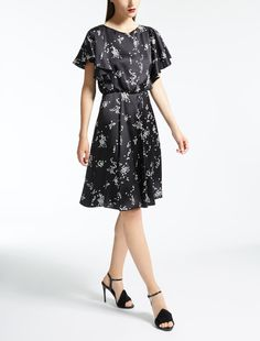 Enter the world of Max Mara: let yourself be won over by the elegance and hand-crafted quality of our collections. Purchase on-line or visit a boutique. Silk Satin Dress, Satin Dresses, Max Mara, A Boutique, Cold Shoulder Dress, Short Sleeve Dresses, Elegant, Black Silk, Dress Black