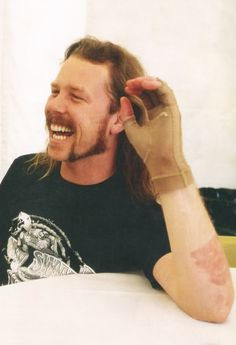 James Hetfield after flames on stage caught him on fire..he is one tough man