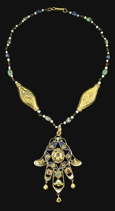 A GOLD AND ENAMELLED NECKLACE WITH A HAND OF FATIMA PENDANT, MOROCCO, 18TH CENTURY