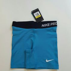 Blue Nike pro shorts Wonderful blue nike pro dri fit athletic spandex shorts with white swoosh and black waist band. This blue is very lovely and is great with your favorite shirt. Perfect gym, yoga, work out, cheerleading shorts. Nike Shorts