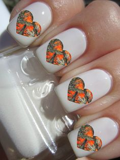 The Orange Camouflage Hearts nail decals will make your nails look amazing!  The nail decals come in a pack of 25 nail decals and look great over