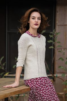 Whether you need a sophisticated or a casual wardrobe for your summer travel, this understated, easy-fitting pullover fits the bill. A welt-and-eyelet panel adds interest to the front, and a soft yarn in merino and linen can span several seasons.