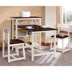 The Espresso and White 3-Piece Dinette Set is the perfect fit for maximizing your small home or apartment's kitchen. Finished in a two-tone white and dark espresso, the simple look has great character for a breakfast nook. One end of the table has a 40-inch high table with ample storage and serving space. It offers two lower shelves, hanging stemware storage and a spacious top surface. The two stool-style chairs with upholstered seats included in the set match the table with their trestle…