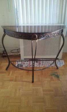 Used (normal wear) - Pre owned in good condition.  This is a great glass and metal antique style table. It has a vintage rustic look due to the detailing on the metal.  This table will spruce up any room in your home.  Height- 31 inches Length- 39 inches
