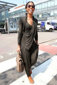 Kelly Rowland was spotted at London Heathrow airport in a matching jersey harem pant set & Givenchy sandals.