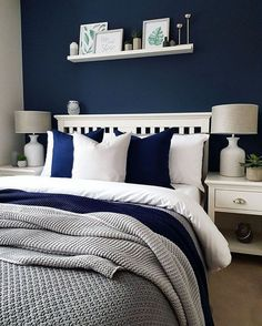 a cozy bedroom done in navy, white and greys looks contrasting, bold yet very in. a cozy bedroom done in navy, white and greys looks contrasting, bold yet very inviting for the master bedroom Navy Blue Bedrooms, Blue Bedroom Decor, Blue Home Decor, Cozy Bedroom, Bedroom Colors, Modern Bedroom, Bedroom Ideas, Master Bedrooms, Modern Bedding