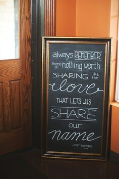 diy wedding chalk board. chalk board lettering. avett brothers lyrics