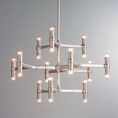 Modern Bamboo Inspired ChandelierThis dramatic bamboo inspired shape chandelier is constructed of light weight die cast aluminum. The unique up and down lamping and chic polished aluminum finish give a contemporary look to an otherwise traditional style element