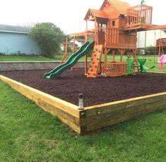 Portfolio | Landscaping by Meyer Retaining Walls - Backyard Playground  Create a fun and safe backyard space for children. Backyard playground with retaining wall, wood, mulch base for a safe landing zone.  #landscaping #backyard #retainingwall #children #kidsoutdoorplayhouse
