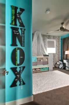 A bold and contemporary installation of baby's name in the nursery - KNOX