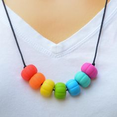 In Rainbows. A teething necklace for you to wear and your baby to chew. Gifts For Mum, Great Gifts, Beaded Necklace, Necklaces, Teething Necklace, Rainbows, Baby, How To Wear, Jewelry