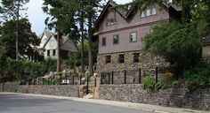 boulder and stone retaining walls on steep hillside